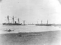 The Ships wrecked at Apia Bay, Samoa, during the Hurricane of March 1889. USS Trenton is on the left, with USS Vandalia hardly visible alongside, and an unknown merchant vessel on its side at her stern. On the right is the USS Nipsic, and in the centre back ground, SMS Olga.
