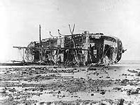 SMS Adler, main gun as yet uncovered, in the aftermath of the Samoa Hurricane.