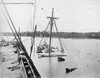 USS Vandalia sunk to the nettings, alongside USS Trenton from which deck the photograph was taken a few days after the Samoa Hurricane of 1889.